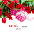 Pile of spring tulips with heart  gift box - Stock Photo