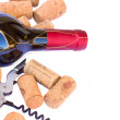 Bottle ofred wine wth corks — Stock Photo