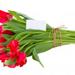 Bouquet of tulips with greeting card — Stock Photo #20438129