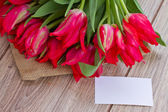 Tulips with greeting card — Stock Photo
