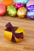 Golden easter egg on wooden table — Stock Photo