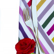 Knife and fork on napkin with flower — Stock Photo