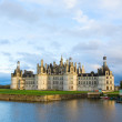 Chambord chateau at sunset, France - Stock Photo