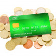 Pile of coins and plastic card — Stock Photo