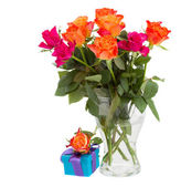Bouquet of orange roses in vase and gift box — Stock Photo