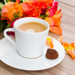 Stock Photo: Cup of coffee with orange roses