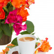 Cup of coffee with roses — Stock Photo