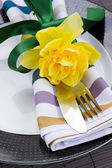 Cutlery serving with narcissus flower — Stock Photo