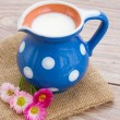 Milk on wooden table — Stock Photo