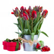 Spring tulip flowers in pot with gift box — Stock Photo #23919561