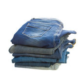 Pile of blue jeans — Stock Photo