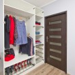 Open wardrobe with clothes — Stock Photo