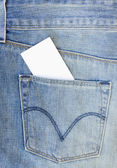 Blue jeans pocket with greeting card — Stock Photo