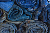 Rols of jeans trousers — Stock Photo