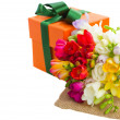 Freesia flowers with gift box — Stock Photo
