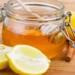 Citrus honey in jar - Stock Photo