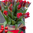 Tulip flowers in pot with gift box — Foto de Stock