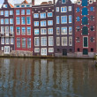 Stock Photo: Medieval houses over water in Amsterdam
