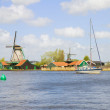 Dutch windmills over Zaan river - Stock Photo