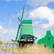 Dutch windmills over  river — Stock Photo