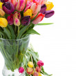 Tulip flowers in glass vase — Stock Photo