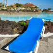 Deckchair standing by the tropical  pool — Stock Photo
