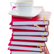 Pile of books with cup of coffee — Stock Photo #25845819