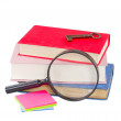 Foto Stock: School stationery and looking glass
