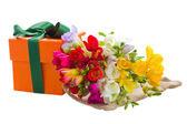 Freesia flowers and gift box — Stock Photo