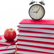Stock Photo: Alarm clock and books on table