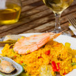 Dining with paella — Stockfoto