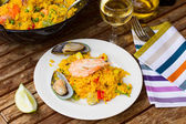 Paella served in plate — Stock Photo