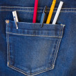 Blue jeans pocket full of pens and pencils — Stock Photo #26409545