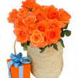 Bouquet of  orange roses in basket — Stock Photo