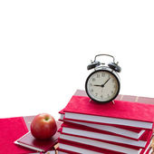 Alarm clock on pile of books — Stock Photo