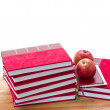Stockfoto: Pile of books and apples