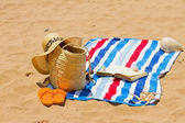 Towel, sunbathing accessories and book — Stock Photo