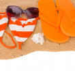 Orange sandals and swimming siut on sand — Foto de stock #26764949