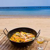 Seafood paella in seaside cafe — Stock Photo