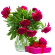 Peony flowers in vase with gift box — Stock Photo #26878707