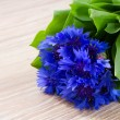 Stock Photo: Blue corn flowers on wooden table