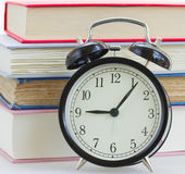Alarm clock on books background — Stock Photo