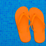 Flip flops in pool water — Stock Photo