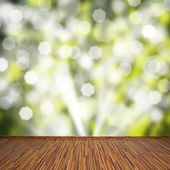 Wooden planks with green bokeh background — Stock fotografie