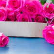 Fresh roses with tag — Stock Photo