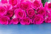Fresh roses on table — Stock Photo