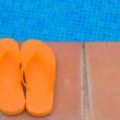 Flip flops on pool side — Stock Photo