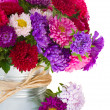 Bouquet of aster flowers in metal pot — Stock Photo