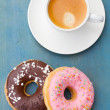 Breakfast with fresh coffee and donuts — Stock Photo
