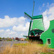 Dutch  green windmills over  river — Stock Photo